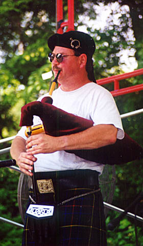 Bob Mitchell playing shuttle pipes